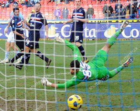 Napoli's Slovakia midfielder Marek Hamsik, left, beats Sampdoria goalkeeper Gianluca Curci, to score his team's third goal against Sampdoria during a Serie A soccer match at Naples' San Paolo stadium, Italy