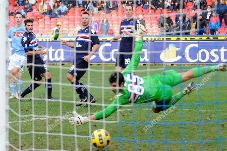 Napoli's Slovakia midfielder Marek Hamsik, left, beats Sampdoria goalkeeper Gianluca Curci, to score his team's third goal against Sampdoria during a Serie A soccer match in Naples' San Paolo stadium, southern Italy