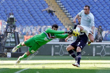 Gianluca Curci, Reto Ziegler, Cristian Brocchi Sampdoria goalkeeper Gianluca Curci, left, fights for the ball with Lazio midfielder Cristian Brocchi, top right, as Sampdoria defender Reto Ziegler, of Switzerland, looks, during a Serie A soccer match between Lazio and Sampdoria, at Rome's Olympic stadium