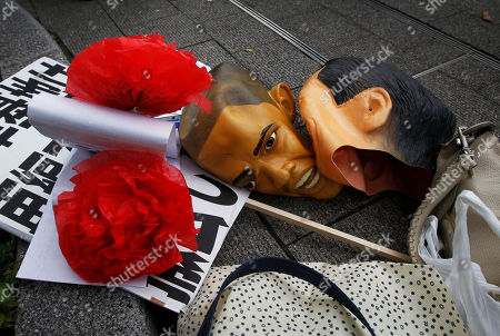 Masks of U.S. President Barack Obama and Japanese Prime Minister Naoto Kan, right, lie on the ground during an anti-APEC demonstration near the APEC summit venue in Yokohama, Japan, . AP Photo/Greg Baker