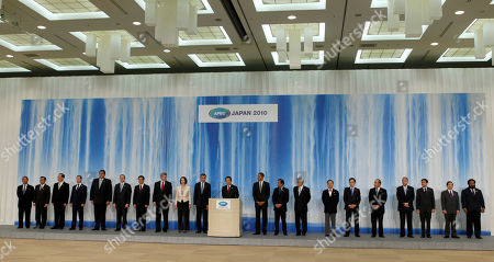 Japanese Prime Minister Naoto Kan, center, speaks at a joint delcaration with other APEC leaders in Yokohama, Japan, . They are, from left, Malaysian Deputy Prime Minister Muhyiddin Yassin, Indonesian Coordinating Economic Minister Hatta Rajasa, Taiwan's National Policy Foundation Chairman Lien Chan, Russian President Dmitry Medvedev, Peruvian President Alan Garcia, New Zealand's Prime Minister John Key, Chinese President Hu Jintao, Canadian Prime Minister Stephen Harper, Australian Prime Minister Julia Gillard, Singaporean Prime Minister Lee Hsien Loong, Kan, President Barack Obama, Brunei Sultan Hassanal Bolkiah, Chilean President Sebastian Pinera, Hong Kong Chief Executive Donald Tsang, South Korean President Lee Myung-bak, Mexican President Felipe Calderon, Philippine President Benigno Aquino III, Thai Prime Minister Abhisit Vejjajiva, Vietnamese President Nguyen Minh Triet and Papua New Guinea Prime Minister Michael Somare