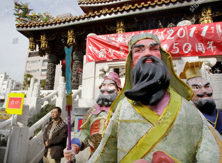 A man walks on the compounds of the Kuan Ti mausoleum dedicated to Chinese historical figure Kuan Yu, center, and his blood brothers Chang Fei, left, and Liu Pei at at Chinatown in Yokohama, south of Tokyo