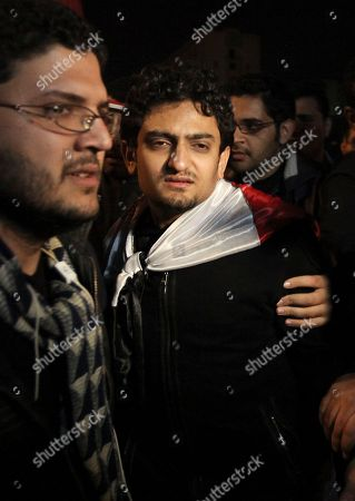 Egyptian Wael Ghonim, right, the 30-year-old Google Inc. marketing manager who was a key organizer of the online campaign that sparked the first protest on Jan. 25, walks into Tahrir Square after Egyptian President Hosni Mubarak's televised statement to his nation, in downtown Cairo, Egypt . Egyptian President Hosni Mubarak announced he is handing his powers over to his vice president, Omar Suleiman, and ordered constitutional amendments Thursday. But the move means he retains his title of president and ensures regime control over the reform process, falling short of protester demands. Protesters in Cairo's central Tahrir Square, hoping he would announce his resignation outright, reacted in fury and disbelief