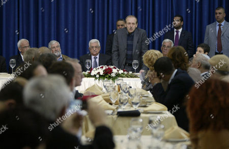 Yasser Abed-Rabbo, a top official of the Palestine Liberation Organization (PLO), standing center right, and Palestinian president Mahmoud Abbas, attend a meeting in the West Bank city of Ramallah, . Palestinian President Mahmoud Abbas hosted dozens of Israeli legislators and peace activists in a rare meeting at his headquarters Sunday and urged them to relay a simple message to the Israeli public, that he is serious about negotiating a peace deal and that the Palestinians will never again resort to violence