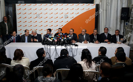 Ali Abdallah, Mohammed Fneish, Abraham Dedeyan, Hussein Hajj Hassan, Jibran Bassil, Mohammed Jawad Khalife, Fady Abboud, Charbel Nahhas, Youssef Saade, Ali Shami From left, Lebanese Ministers Ali Abdallah, Mohammed Fneish, Abraham Dedeyan, Hussein Hajj Hassan, Jibran Bassil, Mohammed Jawad Khalife, Fady Abboud, Charbel Nahhas, Youssef Saade and Ali Shami hold a press conference to announce their resignation in the northern Beirut suburb of Rabieh, Lebanon, . Lebanon's government collapsed Wednesday after Hezbollah ministers and their allies resigned over a U.N.-backed tribunal investigating the assassination of former Prime Minister Rafik Hariri