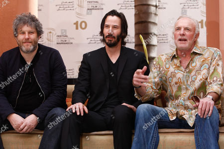 Malcolm Venville, Keanu Reeves, James Caan British director Malcolm Venville left, Canadian actor Keanu Reeves, center and US actor, James Caan, right, pose during a photo call for their film 'Henry's Crimes', at the 10th Marrakech International Film Festival in Marrakech, in Marrakesh. The festival runs through Dec. 3-11 and focuses on new films from Eastern Europe and Asia