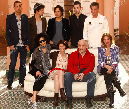 Maggie Cheung, Irene Jacob,John Malkovich, Yousra, Faouzi Bensaidi, Riccardo Scamarcio, Gael Garcia Bernal, Dominic Cooper, Benoit Jacquot From left sitting Jury members of the 10th Marrakech International Film Festival, Hong Kong actress, Maggie Cheung, French actress, Irene Jacob, jury's President U.S actor and film-maker, John Malkovich, Egyptian actress, Yousra, from left standing, Moroccan director, Faouzi Bensaidi, Italian actor, Riccardo Scamarcio, Mexican actor, Gael Garcia Bernal, British actor, Dominic Cooper and French director, Benoit Jacquot, pose during a photocall in Marrakech, in Marrakesh. The festival runs through Dec. 3-11 and is focuses on new films from Eastern Europe and Asia