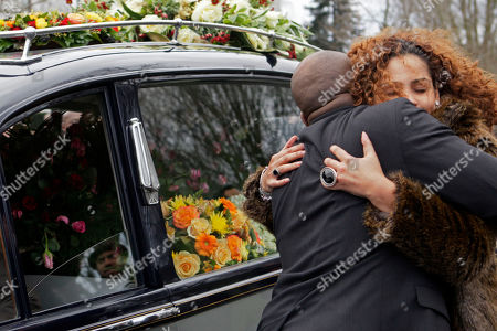 Zanillya Farrell is comforted next to the hearse carrying the body of her father, Boney M singer Bobby Farrell, in Amsterdam, Netherlands, . Farrell whose group Boney M topped the 1970s European charts with glittering showmanship and a dance floor filling blend of disco and Calypso music, died of heart disease. Farrell, a 61-year-old native of Aruba, was found dead Dec. 30 in his hotel room in St. Petersburg, where the group had come for a performance
