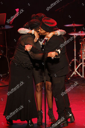 The three Boney M singers Liz Mitchell, left, Maizie Williams, rear, and Marcia Barret, right, hug on stage after bringing hommage to deceased Boney M singer Bobby Farrell in Stadsschouwburg theatre in Amsterdam, Netherlands, . Farrell whose group Boney M topped the 1970s European charts with glittering showmanship and a dance floor filling blend of disco and Calypso music, died of heart disease. Farrell, a 61-year-old native of Aruba, was found dead Dec. 30 in his hotel room in St. Petersburg, where the group had come for a performance