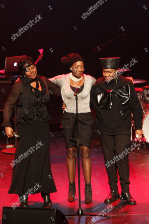 The three Boney M singers Liz Mitchell, Maizie Williams and Marcia Barret, form left to right, bring hommage to deceased Boney M singer Bobby Farrell in Stadsschouwburg theatre in Amsterdam, Netherlands, . Farrell whose group Boney M topped the 1970s European charts with glittering showmanship and a dance floor filling blend of disco and Calypso music, died of heart disease. Farrell, a 61-year-old native of Aruba, was found dead Dec. 30 in his hotel room in St. Petersburg, where the group had come for a performance