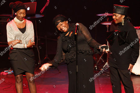 The three Boney M singers, Maizie Williams, Liz Mitchell, and Marcia Barret, left to right, bring hommage to deceased Boney M singer Bobby Farrell in Stadsschouwburg theatre in Amsterdam, Netherlands, . Farrell whose group Boney M topped the 1970s European charts with glittering showmanship and a dance floor filling blend of disco and Calypso music, died of heart disease. Farrell, a 61-year-old native of Aruba, was found dead Dec. 30 in his hotel room in St. Petersburg, where the group had come for a performance