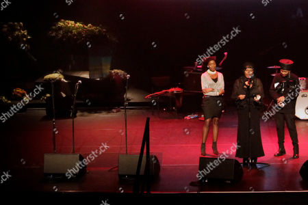 The three Boney M singers, Maizie Williams, Liz Mitchell, and Marcia Barret, left to right, bring homage to deceased Boney M singer Bobby Farrell, as his coffin is seen on the podium left, in Amsterdam, Netherlands, . Farrell whose group Boney M topped the 1970s European charts with glittering showmanship and a dance floor filling blend of disco and Calypso music, died of heart disease. Farrell, a 61-year-old native of Aruba, was found dead Dec. 30 in his hotel room in St. Petersburg, where the group had come for a performance