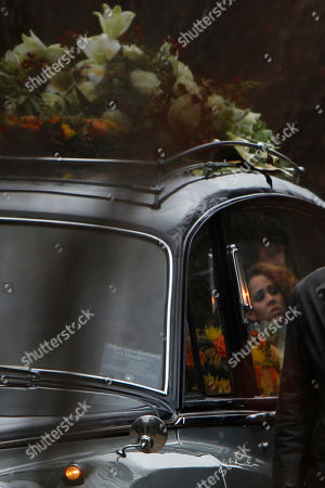 The face of his daughter Zanillya Farrell is reflected in the window of the hearse carrying the body of Boney M singer Bobby Farrell in Amsterdam, Netherlands, . Farrell whose group Boney M topped the 1970s European charts with glittering showmanship and a dance floor filling blend of disco and Calypso music, died of heart disease. Farrell, a 61-year-old native of Aruba, was found dead Dec. 30 in his hotel room in St. Petersburg, where the group had come for a performance