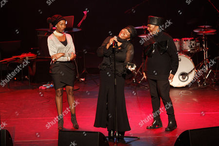 The three Boney M singers, Maizie Williams, Liz Mitchell, and Marcia Barret, left to right, give homage to deceased Boney M singer Bobby Farrell in Stadsschouwburg theatre in Amsterdam, Netherlands, . Farrell whose group Boney M topped the 1970s European charts with glittering showmanship and a dance floor filling blend of disco and Calypso music, died of heart disease. Farrell, a 61-year-old native of Aruba, was found dead Dec. 30 in his hotel room in St. Petersburg, where the group had come for a performance