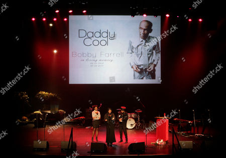The three Boney M singers, Maizie Williams, Liz Mitchell, and Marcia Barret, left to right, pay homage to deceased Boney M singer Bobby Farrell, next to his coffin, on the podium left, in Amsterdam, Netherlands, . Farrell whose group Boney M topped the 1970's European charts with glittering showmanship and a dance floor filling blend of disco and Calypso music, died of heart disease. Farrell, a 61-year-old native of Aruba, was found dead Dec. 30 in his hotel room in St. Petersburg, where the group had come for a performance
