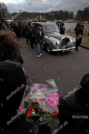 Mourners follow the car with the coffin of Boney M singer Bobby Farrell during his funeral in Amsterdam, Netherlands, . Farrell whose group Boney M topped the 1970s European charts with glittering showmanship and a dance floor filling blend of disco and Calypso music, died of heart disease. Farrell, a 61-year-old native of Aruba, was found dead Dec. 30 in his hotel room in St. Petersburg, where the group had come for a performance