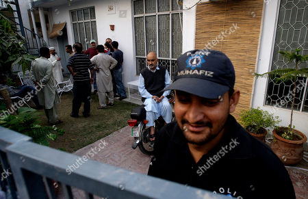 Police at the house of Pakistani cricket wicketkeeper Zulqarnain Haider in Lahore, Pakistan on . Haider went missing Monday from the team hotel before its deciding one-day match against South Africa in the United Arab Emirates, a Pakistani Cricket Board spokesman said