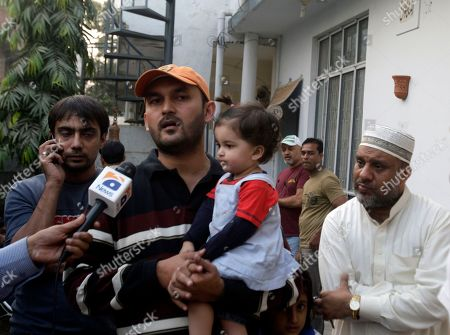 Raza Haider brother of Pakistani wicketkeeper Zulqarnain Haider talks to media in Lahore, Pakistan on . Haider went missing Monday from the team hotel before its deciding one-day match against South Africa in the United Arab Emirates, a Pakistani Cricket Board spokesman said