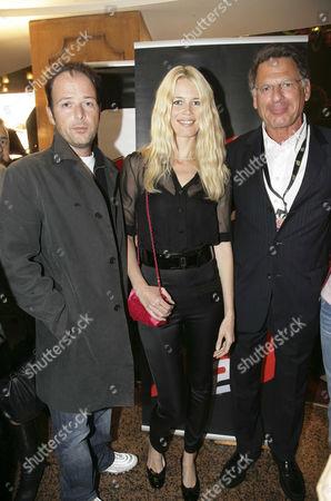 Stock Image of Matthew Vaughn, Claudia Schiffer with the CEO of NRJ, Jean-Paul Baudecroux