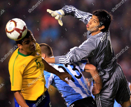 Argentina's goalkeeper Esteban Andrade, right, fights for the ball with Brazil's Carlos Henrique Casimiro, left, in their U-20 South American Championship soccer game in Arequipa, Peru