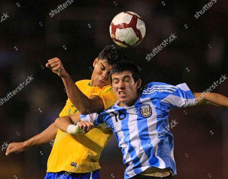 Argentina's Rodrigo Battaglia, right, fights for the ball with Brazil's Carlos Henrique Casimiro in their U-20 South American Championship soccer game in Arequipa, Peru