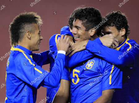 Brazil's Carlos Henrique Casimiro (5) celebrates with teammates after scoring against Colombia during an U-20 South American Championship soccer game in Arequipa, Peru