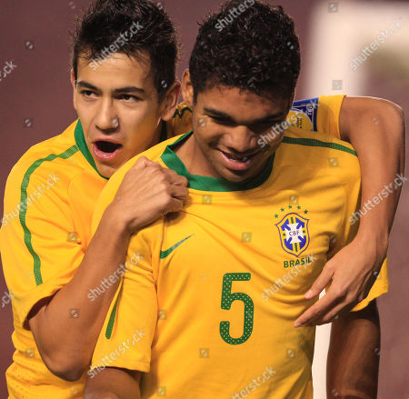 Brazil's Carlos Henrique Casimiro, right, celebrates with teammate Saimon Tormen after scoring against Ecuador during an U-20 South American Championship soccer game in Arequipa, Peru