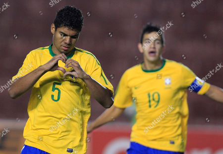 Brazil's Carlos Henrique Casimiro, left, celebrates next to teammate Saimon Tormen after scoring against Ecuador during an U-20 South American Championship soccer game in Arequipa, Peru
