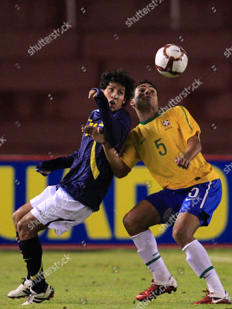 Ecuador's Carlos Alava, left, fights for the ball with Brazil's Carlos Henrique Casimiro during an U-20 South American Championship soccer game in Arequipa, Peru