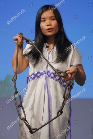 Zoya Phan from Burma addresses the Conservative Party congress holding a chain of metal shackles to highlight the current Burma crisis