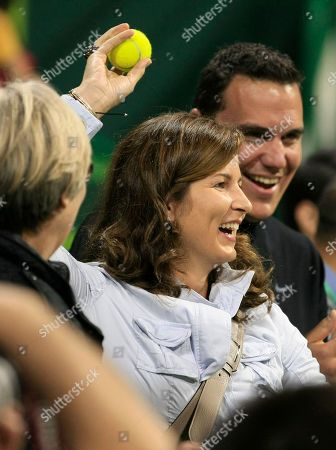 Mirka Vavrinec, wife of Switzerland's Roger Federer celebrates after her husband defeating Nikolay Davydenko of Russia during their final match at Qatar ATP Open Tennis tournament in Doha, Qatar, . Federer won 6-3, 6-4