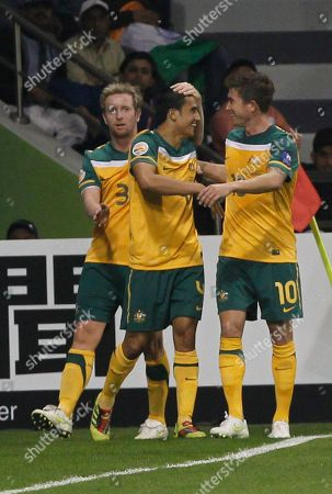 Australia's Tim Cahill, center, is congratulated by his teammates David Carney, left, and Harry Kewell after scoring his second goal against India during their AFC Asian Cup group C soccer match at Al Saad Stadium, in Doha, Qatar