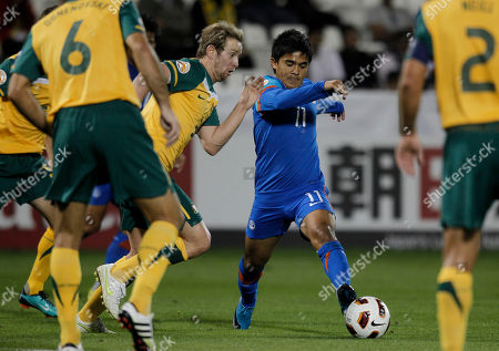 India's Sunil Chhetri vies for the ball with Australia's David Carney during their AFC Asian Cup group C soccer match at Al-Saad stadium in Doha, Qatar