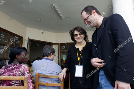 Danielle Mitterrand Danielle Mitterrand, center, widow of former French President Francois Mitterrand, is escorted by an organizer as she leaves after participating in a panel discussion on water access rights as part of the World Social Forum in Dakar, Senegal, . The World Social Forum, taking place this year from February 6th to 11th in Dakar, is an annual counterpart to the World Economic Forum, held last month in Davos, Switzerland