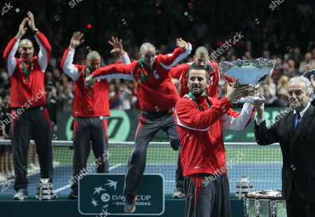 Bogdan Obradovic, Francesco Ricci Bitti Bogdan Obradovic, second left, the Serbian national tennis team captain, receives the Davis Cup trophy from Francesco Ricci Bitti, left, the ITF president, after the Serbian national tennis team won the Davis Cup finals against France in Belgrade, Serbia