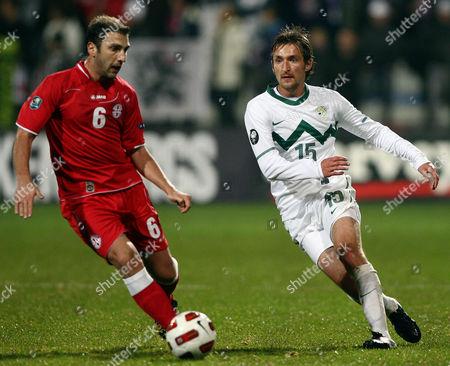 Slovenia's Armin Bacinovic, right, is challenged by Georgia's Zurab Khizanishvili during a friendly soccer match between Slovenia and Georgia in Koper, Slovenia, Wednsday, Nov. 17, 2010