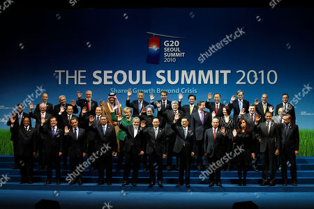 G-20 leaders pose for a group photo at the G-20 summit in Seoul, South Korea, . Top row, left to right: World Trade Organization chief Pascal Lamy; International Monetary Fund Managing Director Dominique Strauss-Kahn; ILO Director-General Juan Somavia; Saudi Arabia's Foreign Minister Prince Saud al-Faisal; Singapore's Prime Minister Lee Hsien Loong; Prime Minister Jose Luis Rodriquez Zapatero of Spain; Prime Minister Nguyen Tan Dung of Vietnam; Secretary-General of the United Nations Ban Ki-moon; World Bank President Robert Zoellick; OECD Secretary-General Angel Gurria; Financial Stability Board (FSB) Chairman Mario Draghi. Second row, left to right: President Bingu wa Mutharika of Malawi; President of the European Council Herman Van Rompuy; Prime Minister Naoto Kan of Japan; Prime Minister Silvio Berlusconi of Italy; Chancellor Angela Merkel of Germany; Prime Minister Manmohan Singh of India; Prime Minister Stephen Harper of Canada; British Prime Minister David Cameron; Prime Minister Julia Gillard of Australia; Commission President Jose Manuel Barroso of the European Union; Prime Minister Meles Zenawi of Ethiopia. Bottom row, left to right: President Jacob Zuma of South Africa; President Dmitry Medvedev of Russia; President Nicolas Sarkozy of France; President Susilo Bambang Yudhoyono of Indonesia; President Luis Inacio Lula da Silva of Brazil; President Lee Myung-bak of South Korea; President Hu Jintao of China; President Felipe Calderon of Mexico; President Cristina Fernandez de Kirchner of Argentina; President Barack Obama of the United States; Prime Minister Recep Tayyip Erdogan of Turkey