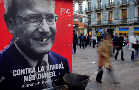 Jose Montilla A woman walks past a vandalized poster of President of the Catalunya regional government Jose Montilla in Barcelona, Spain, . In Catalonia's elections, many see the beginning of the end of the Socialists' grip on power in Spain. Prime Minister Jose Luis Rodriguez Zapatero's party is expected to suffer a big loss in the weekend ballot punishment for the country's economic woes that could snowball into a string of setbacks culminating in defeat in national elections in 2012. The rich northeastern region has long sought an independent voice, but is here seen as a speaking for a wave of national anger over Zapatero's handling of a financial crisis that some fear will require Spain to seek a painful and humiliating bailout. Defeat for the Catalan Socialists would be a big blow for Zapatero as his party prepares to head into nationwide municipal elections and 13 regional government ballots in May. A survey by the Center for Sociological Research said the Catalan Socialists could dip from their current 37 seats to 33 while Artur Mas' CiU may jump from 48 to 59 nine short of a majority and opening the door to several coalition scenarios