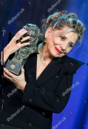 Stock Photo of Isona Passola Producer Isona Passola clutches her best film Goya award for Pan Negro during the annual Goya film awards in Madrid in the early hours of . AP Photo/Paul White