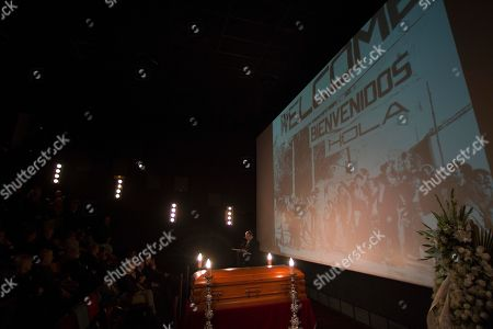 """Stock Image of Alex de la Iglesia Spanish film director academy president Alex de la Iglesia reads a tribute by the coffin of Spanish film director Luis Garcia Berlanga lying in wake at the Spanish Film Academy in Madrid . Berlanga had been suffering from Alzheimer's disease and is survived by a son, Fernando. Projection in background is from Berlanga's movie """"Bienvenido, Mister Marshall"""" (Welcome Mr. Marshall"""