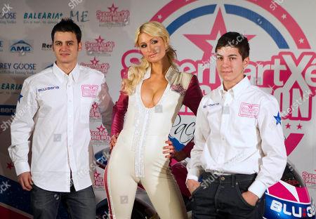 Paris Hilton, Sergio Gadea, Maverick Vinales Paris Hilton poses with Spanish riders Sergio Gadea, left and Maverick Vinales during the presentation of the new SuperMartxe VIP Paris Hilton 125cc racing team in Madrid