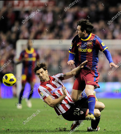 Lionel Messi, Aitor Ocio Barcelona's Lionel Messi from Argentina, right, duel for the ball in front of Athletic Bilbao's Aitor Ocio during their Spanish second-leg Copa del Rey soccer match at San Mames stadium in Bilbao northern Spain Wednesday Jan.5, 2011
