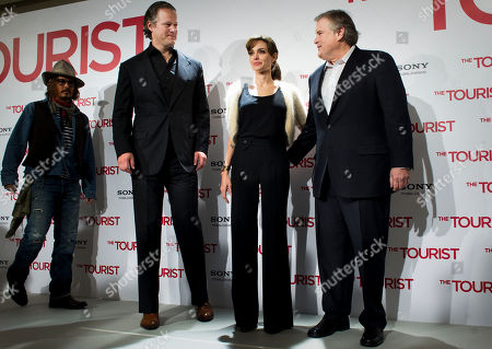 """Johnny Depp, Angelina Jolie, Tim Headington, Florian Henckel von Donnersmarck From left, Johnny Depp, director Florian Henckel von Donnersmarck, Angelina Jolie and producer Tim Headington, right, attend a photo call to promote their movie """"The Tourist"""" in Madrid on"""