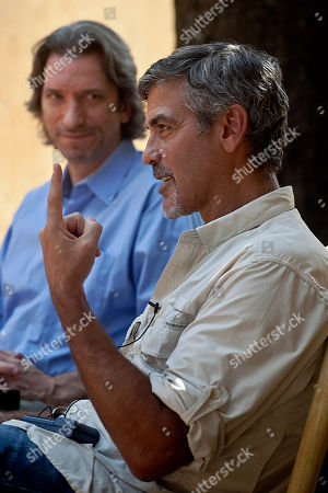 US actor and activist, George Clooney, during an interview in the southern Sudanese capital city of Juba on . Clooney is visiting southern Sudan in a bid to draw attention to the situation as southern Sudanese prepare to vote in an independence referendum that will determine whether the region secedes from the north to form the world's newest country. His visit is the second in recent months, part of an advocacy campaign that landed him meetings with US President Barak Obama and other ranking US foreign policy officials. In the background is John Prendergast, an American analyst of African conflicts and the director of the ENOUGH campaign