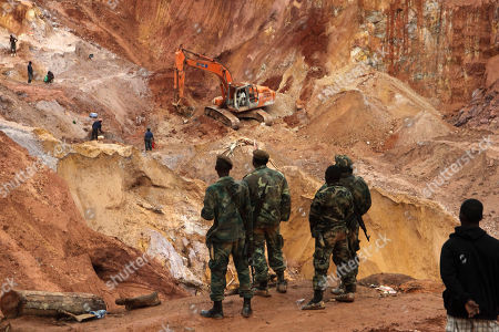 "Soldiers watch the recovery operation of the bodies of unauthorized miners from a pit mine which collapsed the previous evening, killing at least seven, on the grounds of a gold mining concession operated by multinational joint venture Surgold, in Sipaliwini district, some 150 kilometers southeast of Suriname's capital Paramaribo, . ""Apparently, miners not associated with our exploration activities had been working at the foot of a 10-meter wall in the area when the slide occurred,"" said Esteban Crespo, Surgold's representative in Suriname"