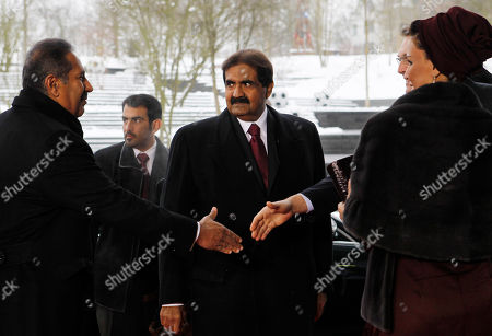 Sheik Hamad bin Khalifa Al-Thani, center, The Emir of the State of Qatar, looks on as Qatar's Prime Minister Sheikh Hamad bin Jassim bin Jaber bin Muhammad Al Thani, left, is welcomed as they arrive at the FIFA headquarters in Zurich, Switzerland, . On right is Sheika Moza bint Nasset Al-Missned, wife of the Emir. FIFA will choose the 2018 and 2022 soccer World Cup hosts with 22 executive committee members after the Oceania Football Confederation accepted the loss of its voting rights late Nov. 30, 2010