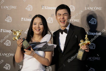"""Ethan Juan Lv Li-Ping Best Leading Actor Taiwanese actor Ethan Juan, right, and Chinese actress Lv Li-Ping hold their awards after their film """"MONGA"""" and """"City Monkey"""" at the 47th Golden Horse Awards, in Taoyuan County, northern Taiwan. The Golden Horse Awards is the Chinese-language film industry's biggest annual events"""