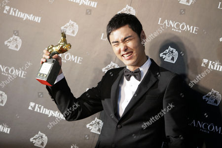 """Ethan Juan Best Leading Actor Taiwanese actor Ethan Juan holds his award for film """"MONGA"""" at the 47th Golden Horse Awards, in Taoyuan County, northern Taiwan. The Golden Horse Awards is the Chinese-language film industry's biggest annual events"""
