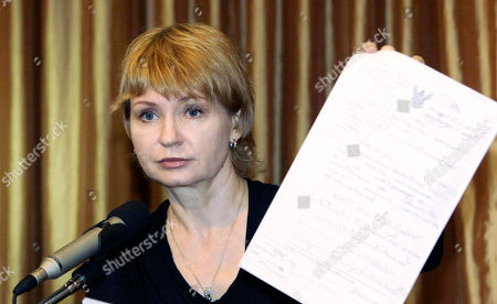 Alla Bout Alla Bout, wife of suspected Russian arms smuggler Viktor Bout, shows a document at Foreign Correspondents Club of Thailand during a press conference in Bangkok, Thailand, . Alla Bout said she will sue the Thai government in an effort to get her husband released from U.S. custody after the Southeast Asian nation extradited him last week