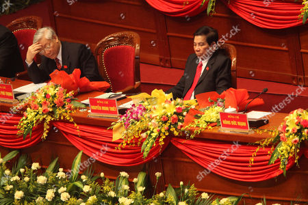 Nguyen Minh Triet, Nguyen Phu Trong Vietnamese President Nguyen Minh Triet, right, and Nguyen Phu Trong, chairman of the National Assembly attend the opening ceremony of the 11th National Congress of Communist Party of Vietnam in Hanoi, Vietnam